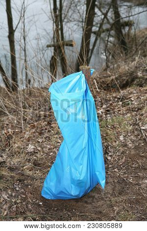 Method Of Suspending Sacks On Waste In Scenic Water.