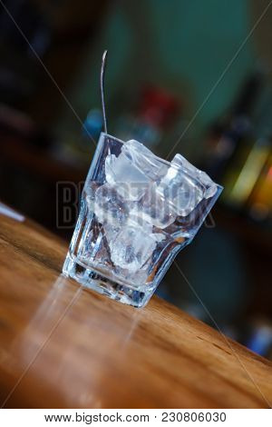 glass of ice on the bar. close-up