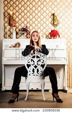 Beautiful blonde near white piano