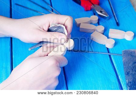 The Master Processes The Wood With His Hands. Working Hands On A Blue Background With Tools. Creatio