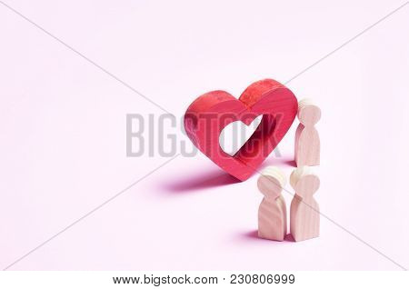 A Man Stands Near The Heart And Confesses Love On A Pink Background. A Person Makes An Offer To Marr