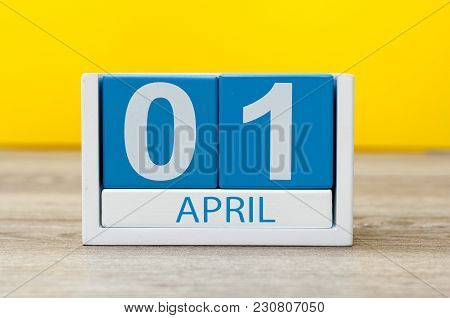 April 1st. Day 1 Of April Month, Calendar On Yellow Background. Spring Time, Easter And Fools Day.