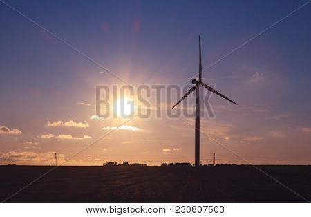 Wind Turbines For Electrical Power Generation In Normandy, France. Countryside And Industrial Landsc