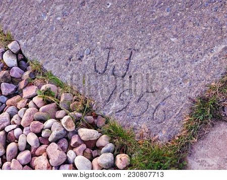 Initials In Sidewalk From 1956 In Clayton, Ny