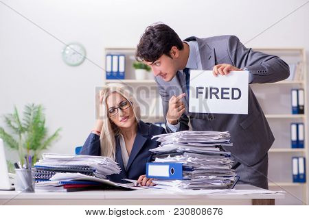 Angry boss firing his assistant secretary