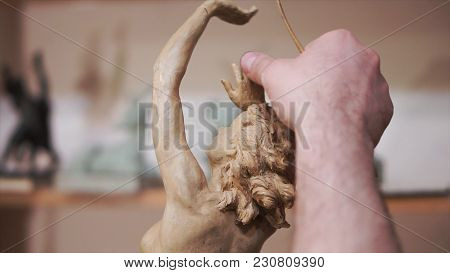 Close Up Of Sculptor Artist Creating A Bust Sculpture. Creating Sculpture. Elderly Sculptor Making S