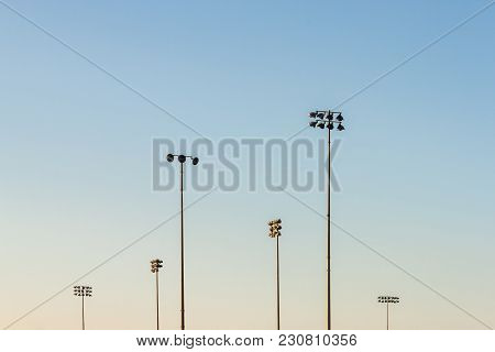 A Nice Afternoon Shot Of Multiple Sports Field Lights With Clear Sky Background.