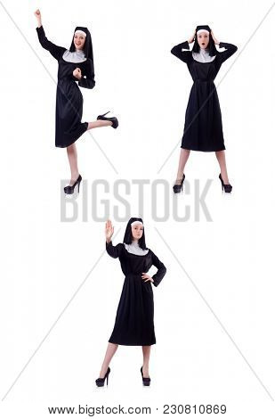 Young serious nun with sign stop isolated on white
