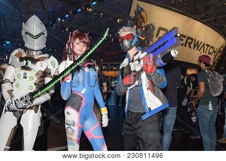 Cologne, Germany - August 24, 2017: Three Cosplayer Are Posing With Weapons At The Trade Fair Gamesc