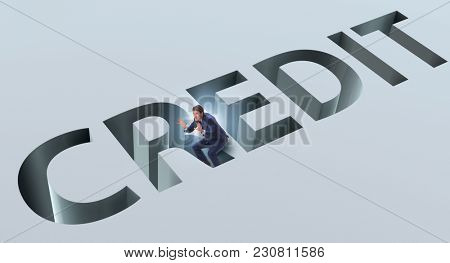 Businessman falling into trap of borrowing debt and credit