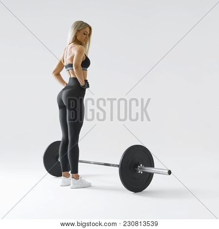 Woman With Barbell In Health Club Female Athlete Before Exercising With Heavy Weights At Gym Bodybui