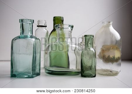 Empty Vintage Apothecary Bottles At The Window