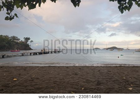 Early Morning And Sunrise At Malendure Beach In Guadeloupe, Caribbean. Place Famous For Its Dark San