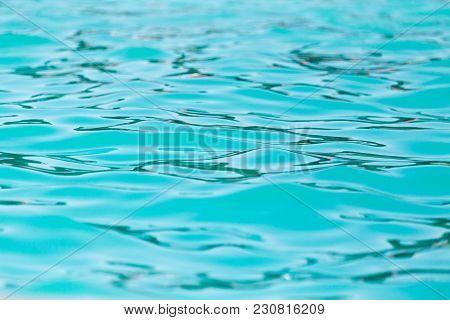 Expanse Of Water In The Pool As A Background .