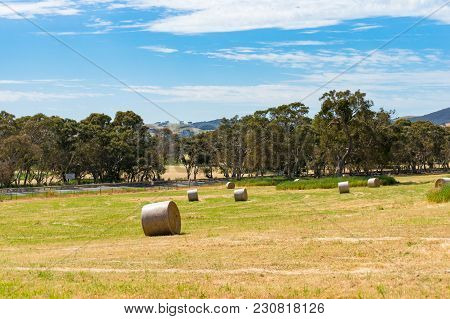 Beautiful Countryside Landscape Of Filed With Straw Bales On Sunny Day