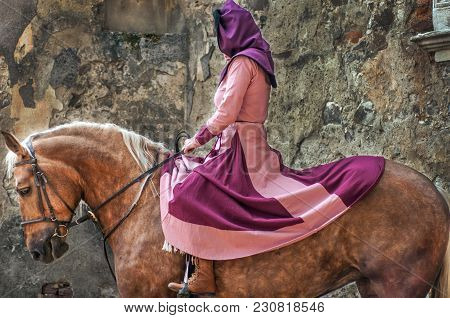 Woman Riding A Horse In Medieval Clothes