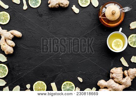 Tea For Cure Colds. Cup, Teapot, Ginger Root And Lemon On Black Background Top View.