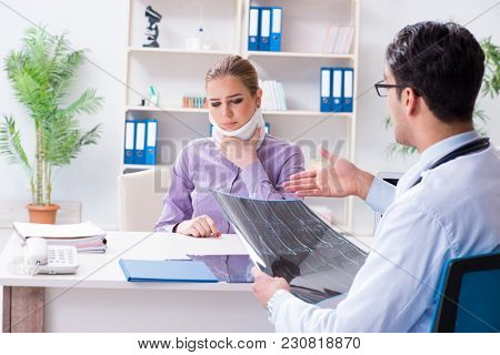 Doctor examining x-ray images of patient