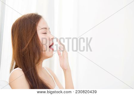 Beautiful Young Asian Woman Yawn Sitting With Sleep On Bed At Bedroom, Girl Wake Up After Resting An
