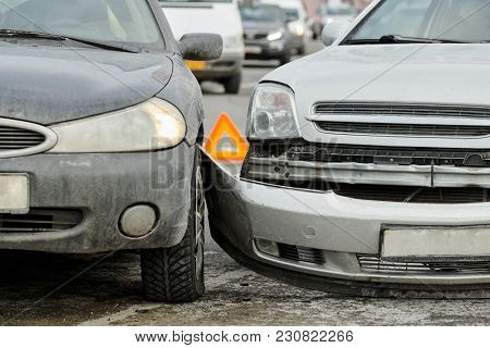 car crash on street, damaged automobiles after collision in city