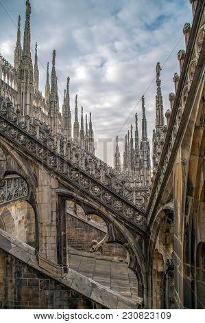 Architectonic Details From Roof Of The Famous Milan Cathedral, Lombardy, Italy. Famous Spire.