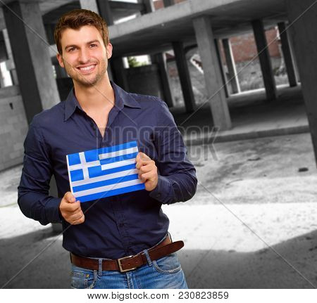 Young Man Holding Greece Flag, Outdoor
