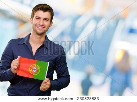 Young Man Holding Portuguese Flag, Indoor