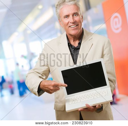 Mature Man With Laptop, indoor