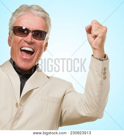 Mature Man With Doing A Success Gesture against a blue background