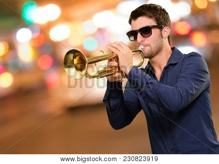 Young Man Holding Trumpet, Outdoor