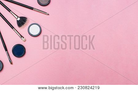 Beauty Composition On A Flat Pink Tabletop: Creative Arrangement Of Make-up Brushes And Shadows. Vas