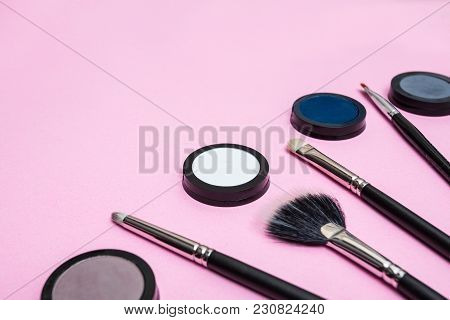 Creative Makeup Arrangement Of Beauty Tools: Brushes And Eyeshadows. Vast Empty Space For A Custom M