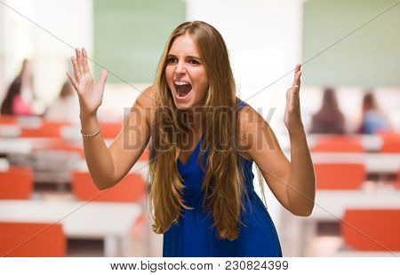 Portrait Of A Young Woman Yelling in a classroom