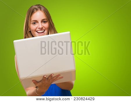 Blonde Woman Holding Laptop against a green background