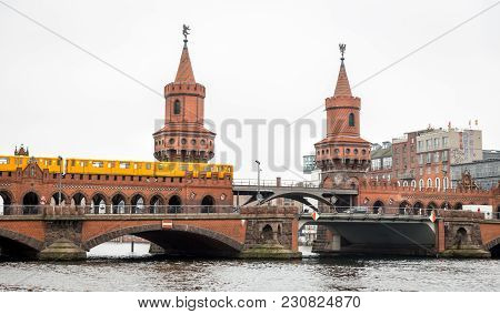 U-bahn Train Passing Over Oberbaum Bridge In Berlin City, Germany
