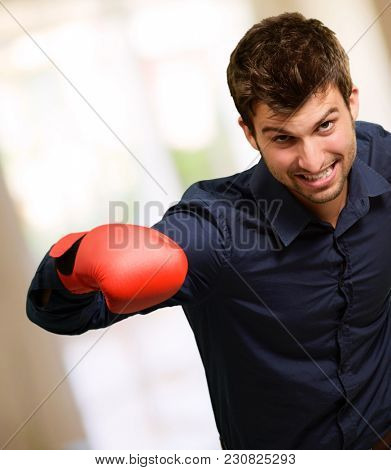 Happy Young Man Wearing Boxing Gloves, Indoors