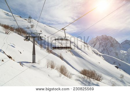 Ski-lift Wire On The Background Of The Snow-white Mountains Of The Caucasus, Dombai On A Winter Sunn