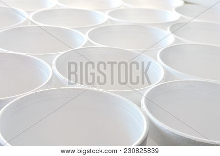 An Abstract Image Of Several White Disposable Styrofoam Cups.