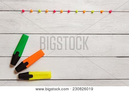 Yellow, Green, Orange Highlighter, Colorful Pushpins On White Wooden Table, Stationary, Copy Space.