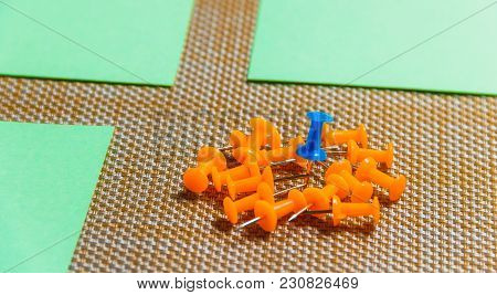 Stationary, Orange, Blue Pushpins Heap On Brown Background, Concept For Difference, Individuality