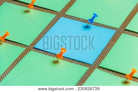 Stationary, Blank Green Blue Sticker Pined On Brown Board. Time-management, Planning