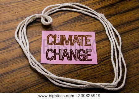 Handwritten Text Showing Climate Change. Business Concept For Global Planet Warming Written On Stick