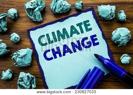 Writing Text Showing Climate Change. Business Concept For Global Planet Warming Written On Sticky No