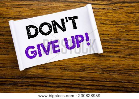 Word, Writing Don T Give Up. Business Concept For Motivation Determination, Written On Sticky Note P