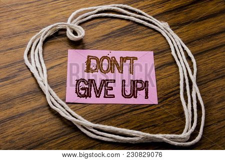 Handwritten Text Showing Don T Give Up. Business Concept For Motivation Determination, Written On St