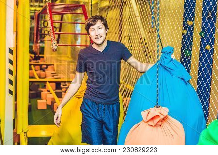 The Man Passes The Obstacle Course In The Sports Club.