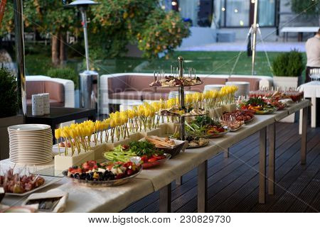 Buffet Served Table With Snacks, Fruits, Canape, Sweets And Appetizers.catering Event Plate Service.