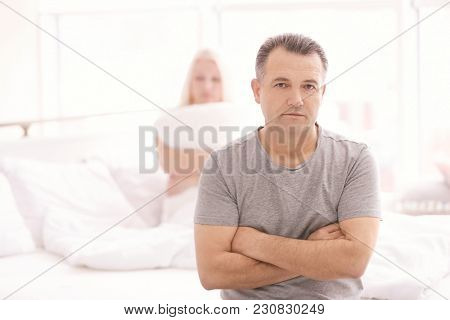 Senior couple with problem in relationship on bed at home