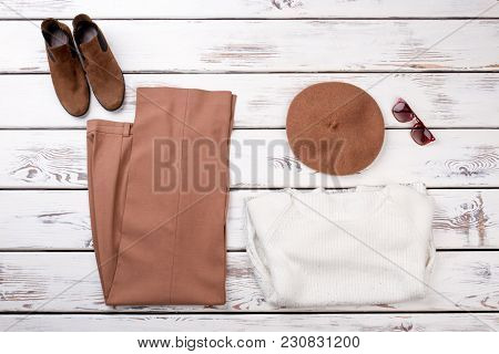 Concept Of Women's Clothes Are Laid Out On The Table.