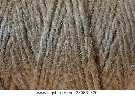 A Close Up Image Of A Spool Of Jute Thread On An Old Wooden Table.